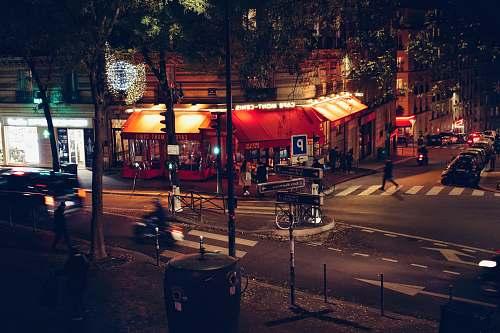 asphalt people in busy city street at night road