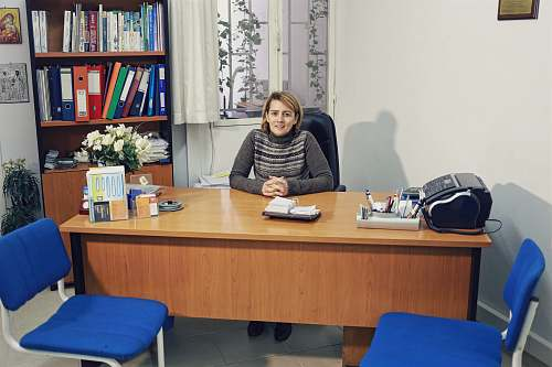 table woman sitting beside desk furniture