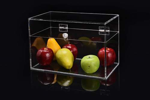 apple apple and pear in clear glass display flora