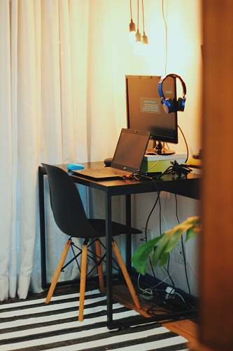 table black wooden office table with laptop and monitor desk