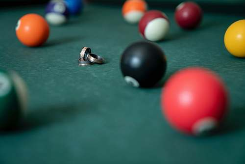 room gold rings surrounded with billiard balls indoors
