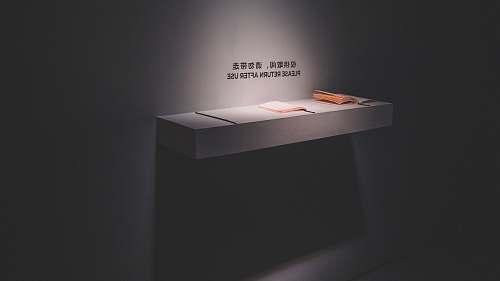 table gray floating shelf reception desk