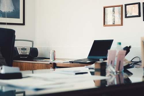 desk selective focus photography of black laptop computer turned-off table