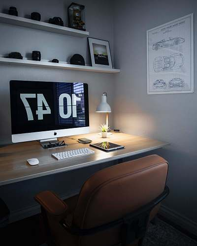 desk silver iMac displaying 10 47 table