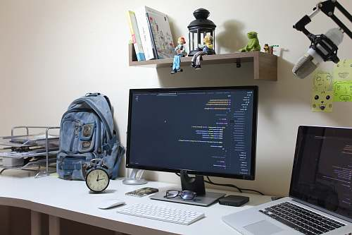 table turned-on flat screen computer monitor desk