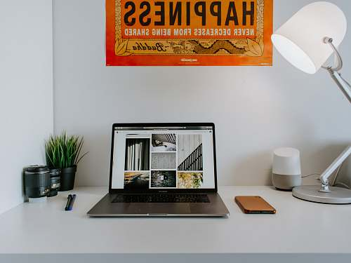 photo table turned-on laptop near desk lamp desk free for commercial use images
