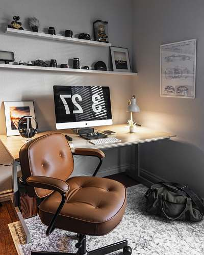 chair turned-on silver iMac table
