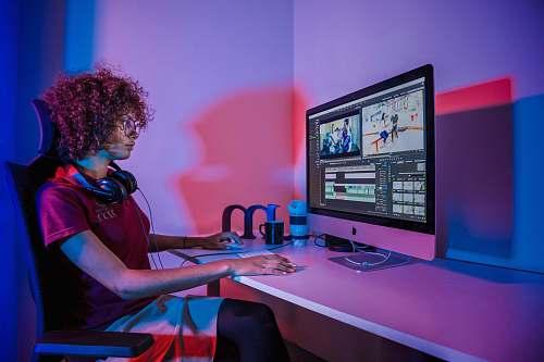 human woman using silver iMac person