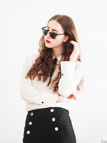 clothing woman in white long sleeve shirt wearing black sunglasses female