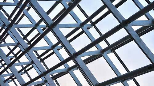 building photo of gray metal structure during daytime skylight