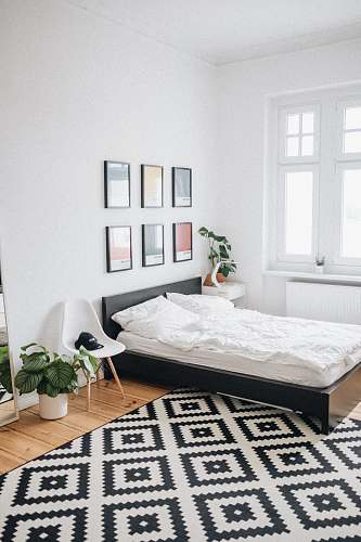 photo interior black platform bed with white mattress inside bedroom germany free for commercial use images