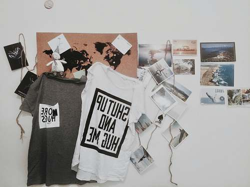 poster two white and gray text-printed hanging shirts t-shirt design