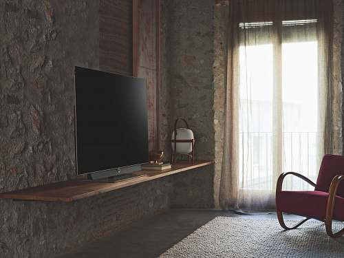 furniture turned-off flat screen television on brown wooden TV stand chair