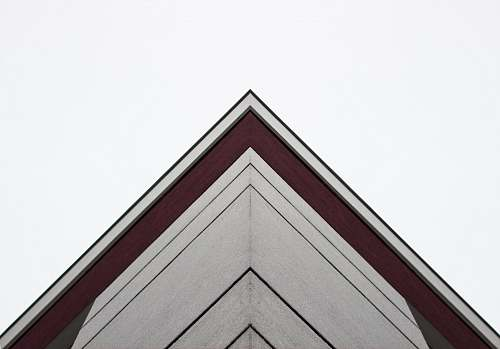 triangle worm's-eye view of white and red building architecture