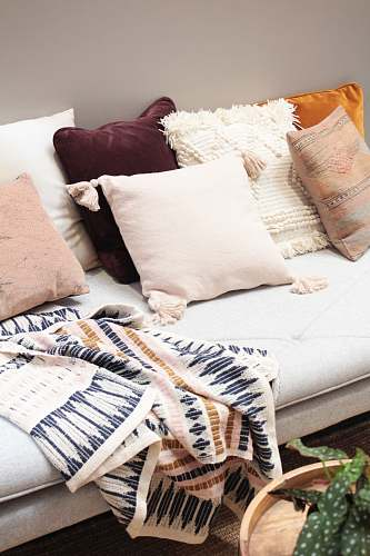 interior assorted throw pillows on gray couch design