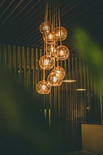 pendant selective focus photography of lit pendant lights hanging