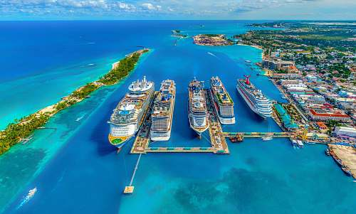 land aerial photography of white and blue cruise ships during daytime nature