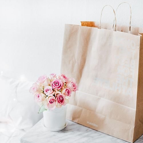 photo pink rose bouquet beside brown paper bag free for commercial use images