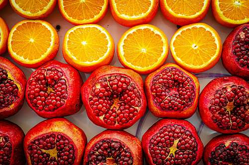 fruit shallow focus photo of sliced orange fruits plant