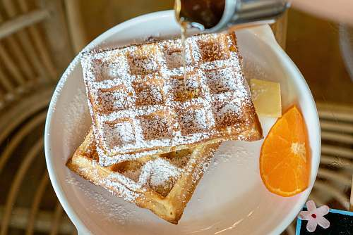 food waffles white on ceramic plate orange