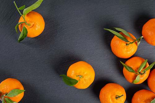 food orange fruits on grey surface citrus fruit