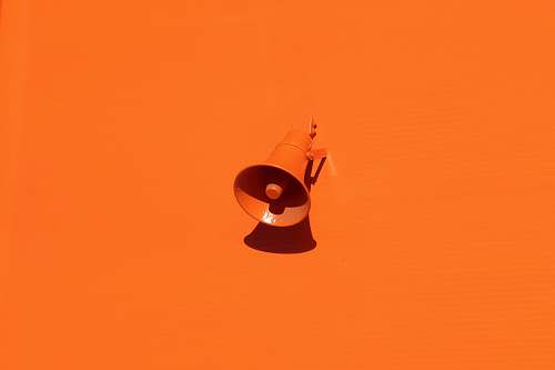 color orange megaphone on orange wall background
