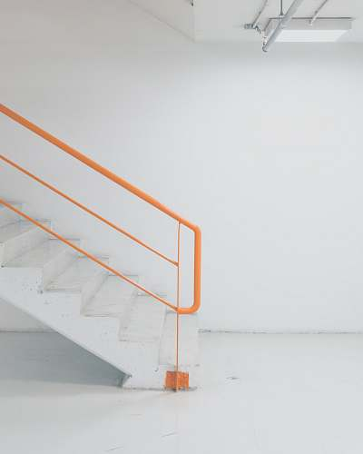 handrail orange metal railing white concrete stairs the mall athens