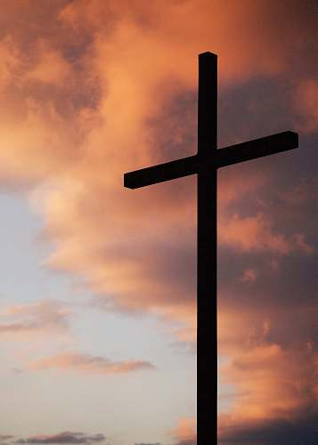 church silhouette of large cross under orange sky christian