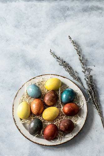 egg assorted-color eggs on white ceramic tray spring
