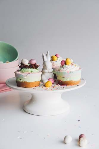 food cakes placed on white ceramic cake stand cake