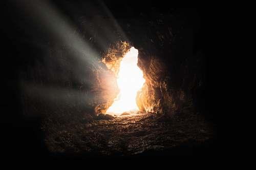 cave sun rays inside cave curacao