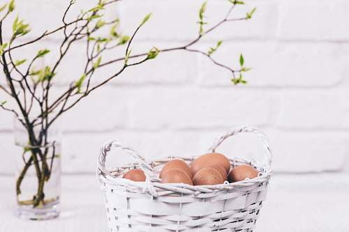 basket brown eggs on white basket blossom