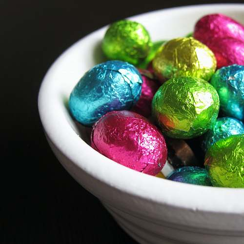candy chocolate eggs in white bowl confectionery