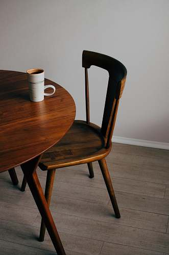 chair white ceramic mug on brown wooden table interior