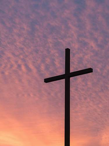 cross silhouette of large cross during daytime church