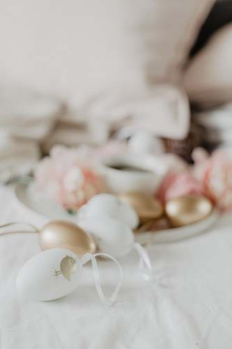 egg white and gold decors on white surface food