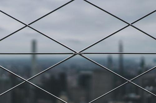 closeup photo of gray metal mesh-link fence