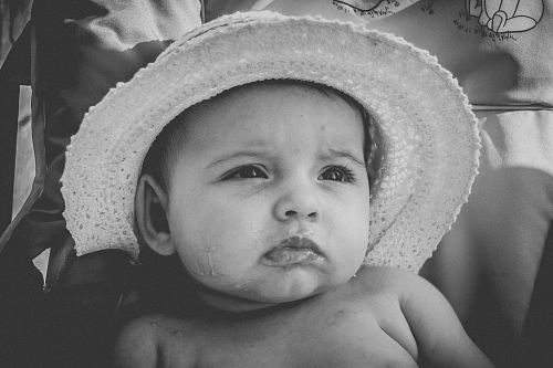 photo grayscale photography of baby wearing hat free for commercial use images