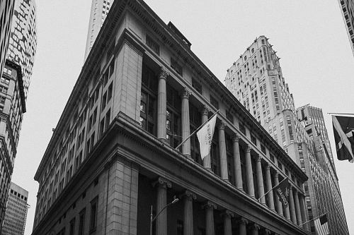 photo grayscale photography of waving flag hanged on building free for commercial use images