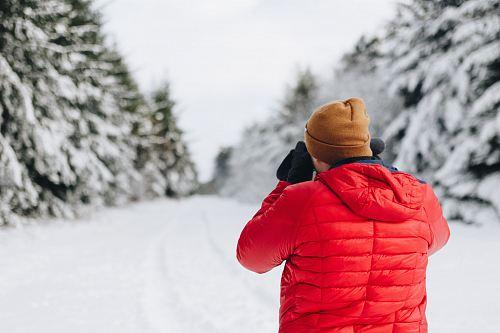 man wearing bubble jacket in snow