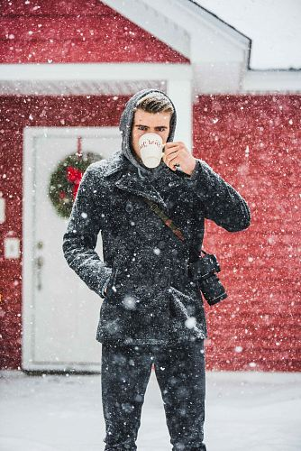 photo man wearing coat using white mug free for commercial use images