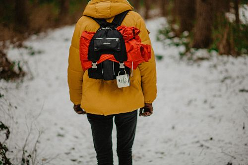 photo person carrying black backpack in road free for commercial use images