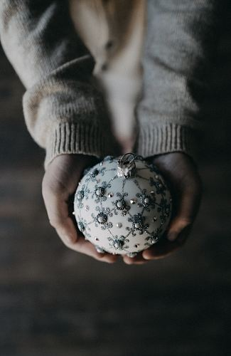 photo person holding bauble ball free for commercial use images