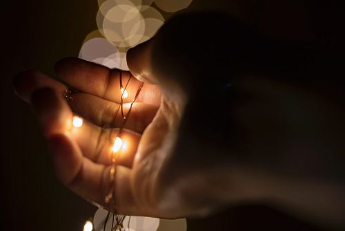 photo person holding lace with yellow lights free for commercial use images