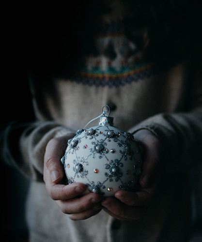 photo person holding white and grey ornament free for commercial use images