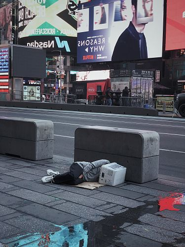 photo person laying on concrete floor beside asphalt road free for commercial use images