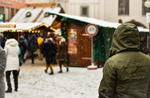 person wearing green hoodie on snow