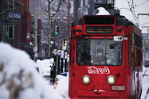 photo red Coca-Cola tram during snow free for commercial use images