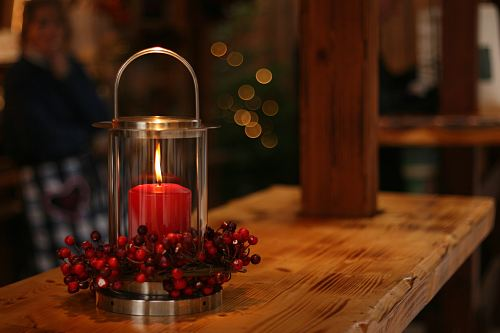 photo red lighted candle on brown wooden frame free for commercial use images