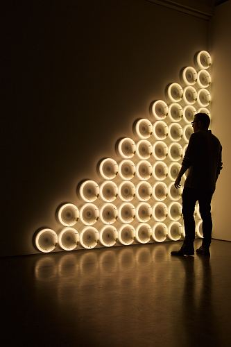 silhouette photo of man standing in front of LED wall lights \